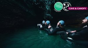 Group-of-people-in-cave-tubing